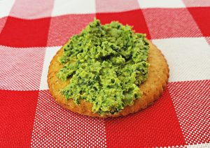 Fava Bean Pesto & Sautéed Greens on a Cracker
